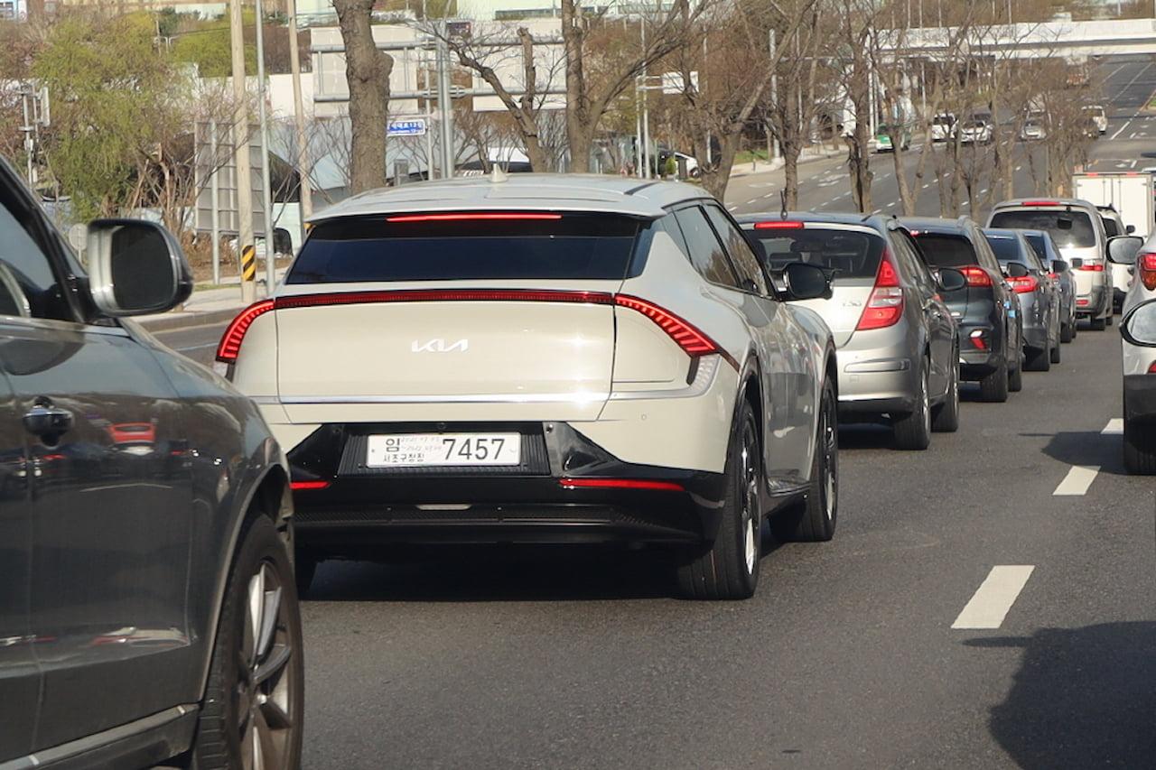 Kia EV6 rear quarters in traffic